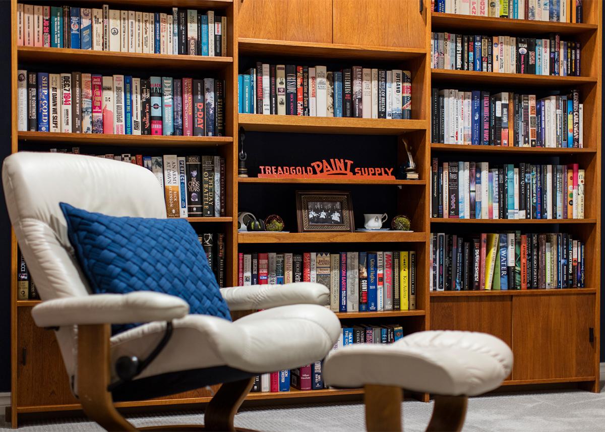 Mid-century condo - upstairs book case | Creative Touch Kelowna Interior Design